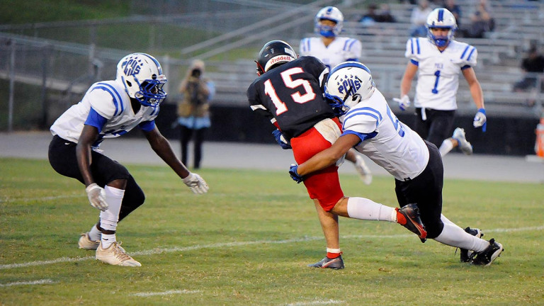 Wall worthy: Polk thumps Patton in conference debut