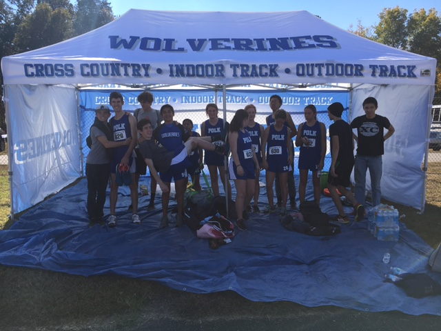 Polk County's cross country team members show off the program's new tent (photo courtesy Alan Peoples).